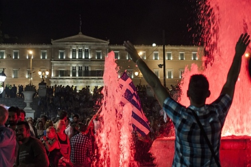 Greeks celebrate outside the Athens parliament3000